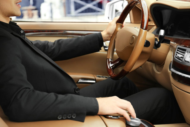 Driver of luxury car